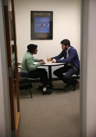 Suzanne Lynch (left) of Boston received advice from Jason Andrade, who is a financial coach.